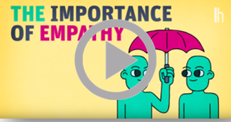 """Screenshot from video """"The Importance of Empathy."""" Two green figures stand side by side under an umbrella held by one of the figures."""