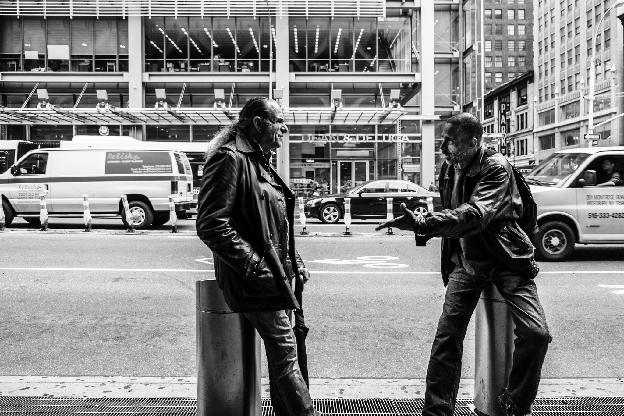 Photograph: two people having a verbal exchange on the sidewalk Reproduced with attribution under Creative Commons license.