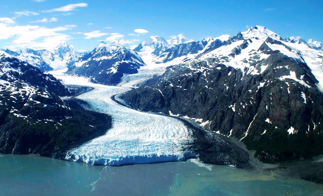 An aerial view of Margerie Glacier. The glacier begins high in the mountains and meanders down the valleys like a river of ice.