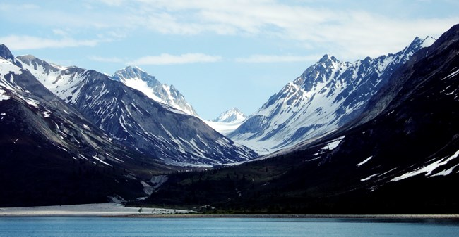 Photograph: A u-shaped valley, carved out over millenia by a glacier.