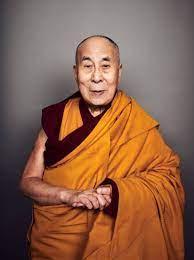 Photo of man Dalai Lama in Gold Maroon Robes